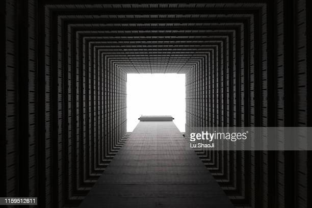 llooking up symmetrical residential buildings in hong kong - kowloon peninsula stock pictures, royalty-free photos & images
