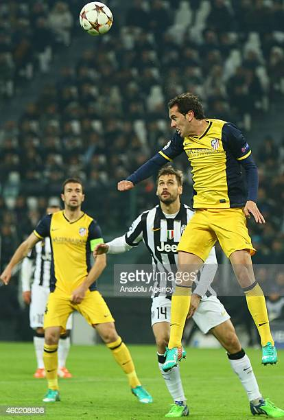 Llorente of Juventus in action against Gabi of Atletico Madrid during the Champions League Group A football match between Juventus and Atletico...