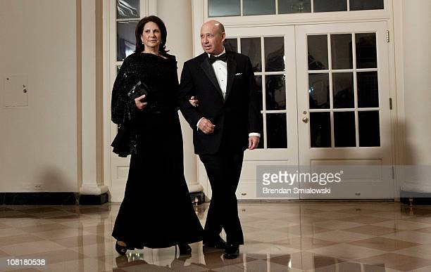 Lloyd Blankfein CEO of Goldman Sachs and his wife Laura Blankfein arrive at the White House for a state dinner 19 2011 in Washington DC President...