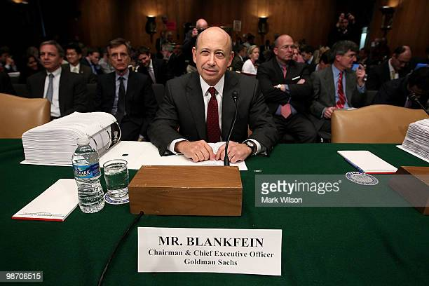 Lloyd Blankfein chairman and CEO of The Goldman Sachs Group hears from a lawyer while preparing to testify before the Senate Homeland Security and...
