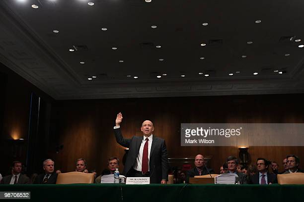 Lloyd Blankfein chairman and CEO of The Goldman Sachs Group is sworn in while testifying before the Senate Homeland Security and Governmental Affairs...