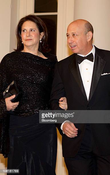 Lloyd Blankfein chairman and chief executive officer of Goldman Sachs Group Inc right and his wife Laura arrive for a state dinner hosted by US...