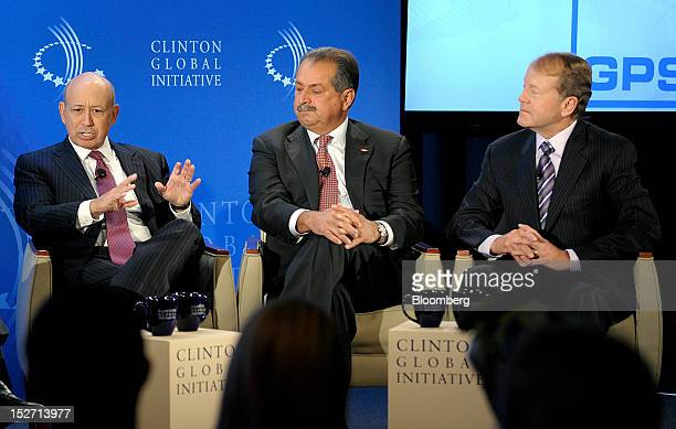 Lloyd Blankfein chairman and chief executive officer of Goldman Sachs Group Inc left speaks during a panel discussion with Andrew Liveris chairman...