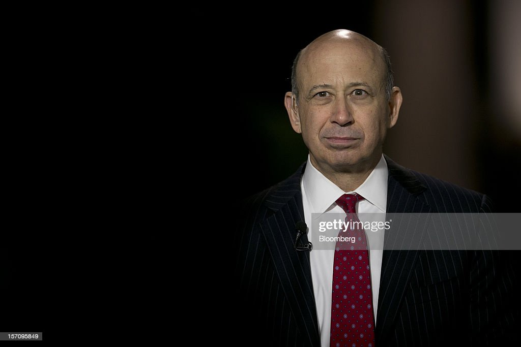 Lloyd Blankfein, chairman and chief executive officer of Goldman Sachs Group Inc., pauses during an interview following a meeting with U.S. President Barack Obama at the White House in Washington, D.C., U.S., on Wednesday, Nov. 28, 2012. Obama reached out to chief executives and middle-income taxpayers, imploring them to press Congress to avoid the fiscal cliff as he said he wants to get a deal 'done before Christmas.' Photographer: Andrew Harrer/Bloomberg via Getty Images