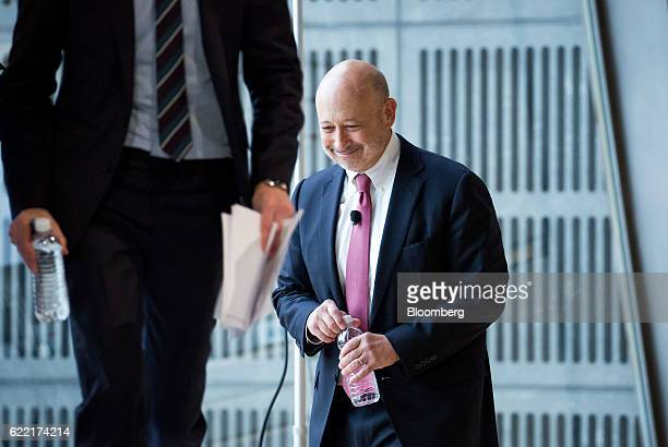 Lloyd Blankfein chairman and chief executive officer of Goldman Sachs Group Inc arrives on stage during the New York Times DealBook conference in New...