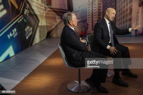 Lloyd Blankfein, chairman and chief executive officer of Goldman Sachs Group Inc., right, speaks while Michael Bloomberg, founder of Bloomberg LP,...