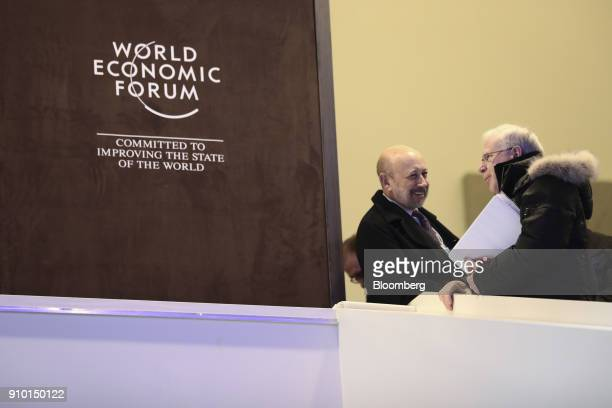 Lloyd Blankfein, chairman and chief executive officer of Goldman Sachs Group Inc., left, speaks to an attendee between sessions on day three of the...
