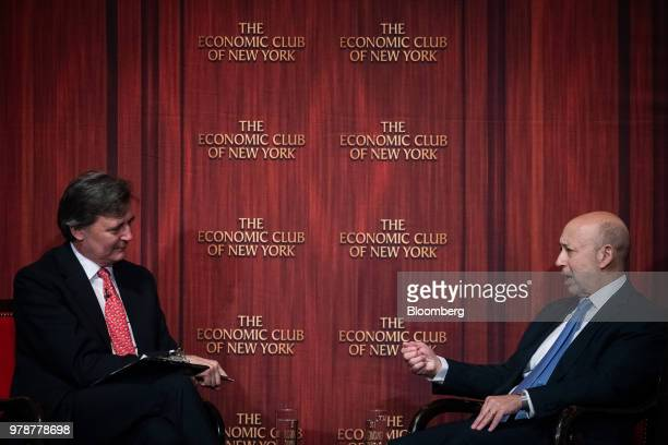 Lloyd Blankfein chairman and chief executive officer of Goldman Sachs Group Inc right speaks during an Economic Club of New York event in New York US...