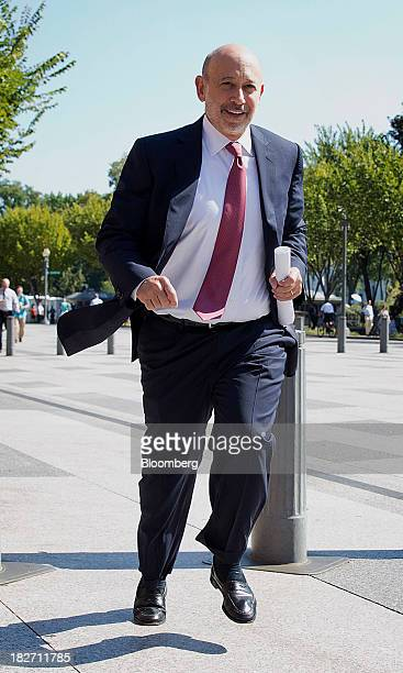 Lloyd Blankfein chief executive officer of Goldman Sachs Group Inc center runs for his bus after a meeting with US President Barack Obama at the...