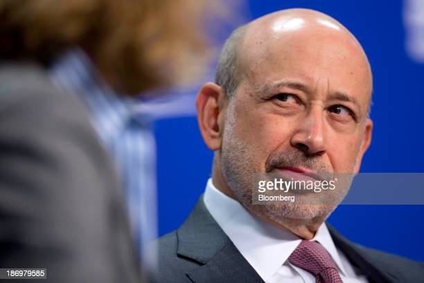 Lloyd Blankfein chief executive officer of Goldman Sachs Group Inc right looks on as Sylvia Burwell director of the Office of Management and Budget...