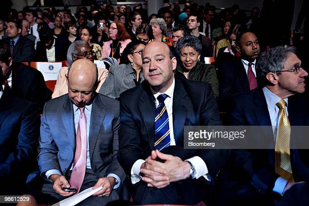 Lloyd C Blankfein chairman and chief executive officer of Goldman Sachs Group Inc left checks his Blackberry mobile phone as he sits with Gary D Cohn...