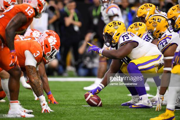 Lloyd Cushenberry III of the LSU Tigers prepares to snap the ball against the Clemson Tigers during the College Football Playoff National...