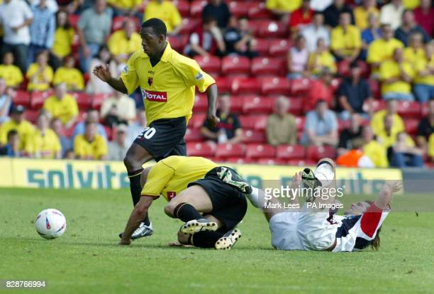 Lloyd doyley and teammate Gavin Mahon of Watford in action with West Bromwich Albion's Andy Johnson during their Nationwide Division One match at...