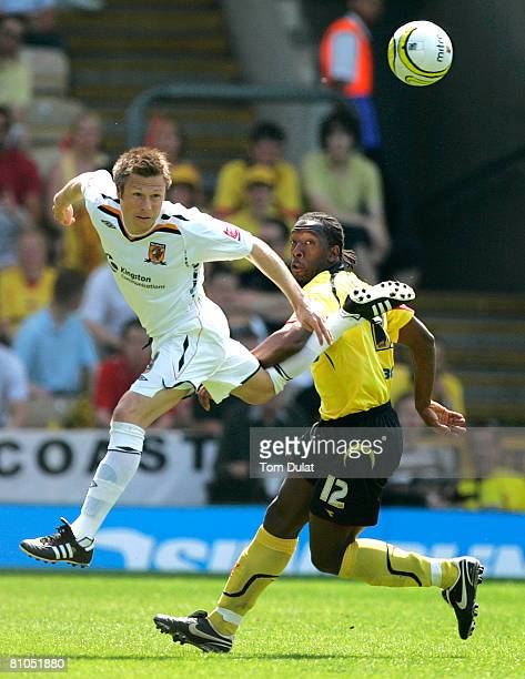 Lloyd Doyley of Watford and Nicky Barmby of Hull City challenge for the ball during the CocaCola Championship Playoff SemiFinal First Leg match...