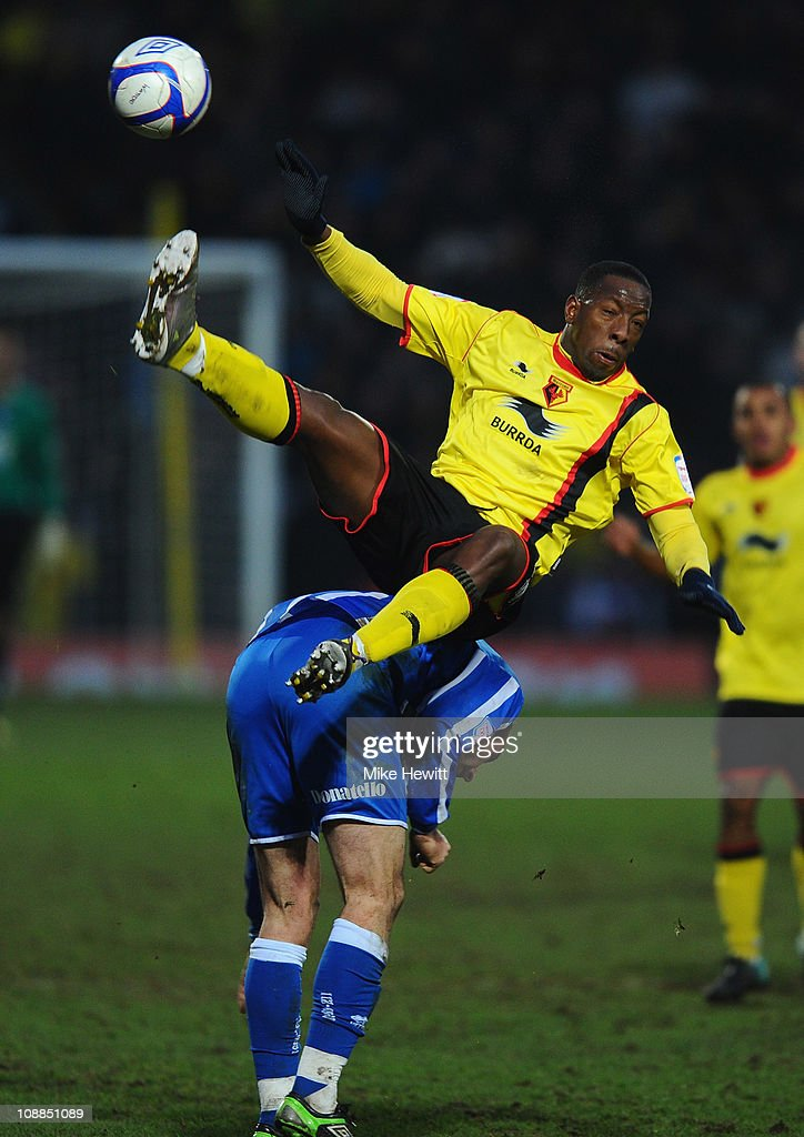Lloyd Doyley of Watford flies over the top of Glenn Murray of Brighton during the FA Cup Sponsored by E.ON 4th Round match between Watford and Brighton & Hove Albion at Vicarage Road on January 29, 2011 in Watford, England.