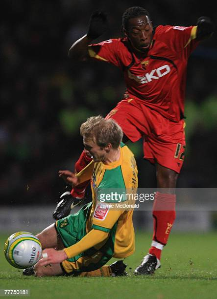 Lloyd Doyley of Watford is tackled by Luke Chadwick of Norwich during the CocaCola Championship match between Norwich City and Watford at Carrow Road...