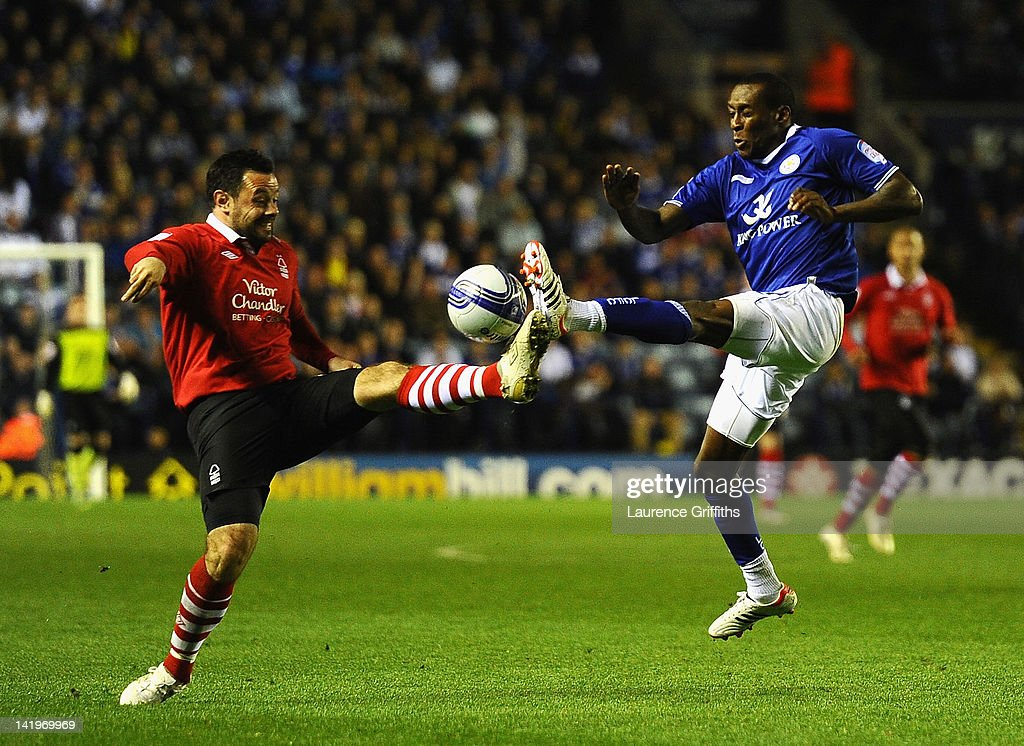 Lloyd Dyer of Leicester City battles with Andy Reid of Nottingham Forest during the npower championship match between Leicester City and Nottingham Forest at The King Power Stadium on March 27, 2012 in Leicester, England.