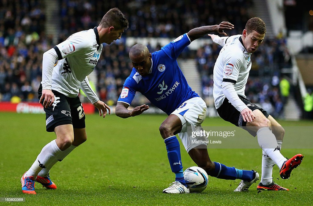 Lloyd Dyer of Leicester looks for a way through the Derby defence of Kieron Freeman and Paul Coutts during the npower Championship match between Derby County and Leicester City at Pride Park Stadium on March 16, 2013 in Derby, England.