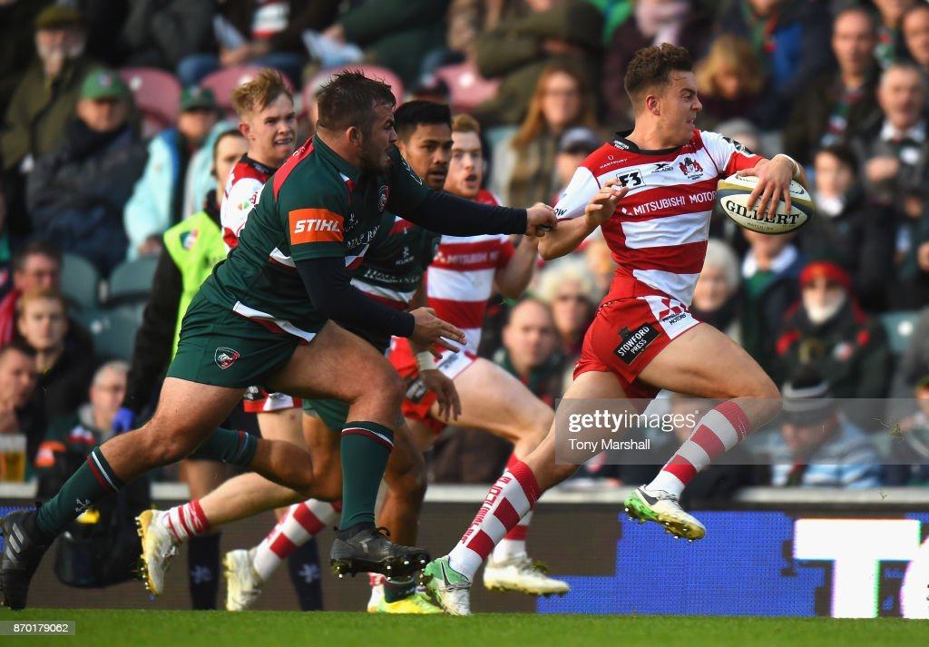 Lloyd Evans of Gloucester Rugby is tackled by George McGuigan of Leicester Tigers during the Anglo-Welsh Cup match at Welford Road on November 4, 2017 in Leicester, England.