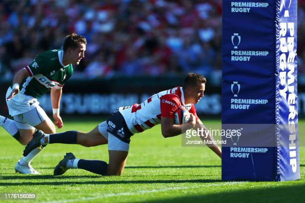 Lloyd Evans of Gloucester touches down a try during the Premiership Rugby Cup match between Gloucester Rugby and London Irish at Kingsholm Stadium on...
