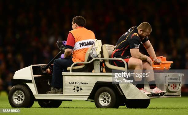 Lloyd Fairbrother of Newport Gwent Dragons reacts as he leaves the field injured during the Guinness Pro12 match between Newport Gwent Dragons and...