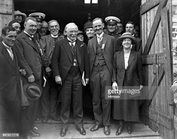 Lloyd George laughing heartily over a joke with the Chaired Bard Mr Cledlyn Davies the principal prizewinner at the Welsh Eisteddfod On the extreime...