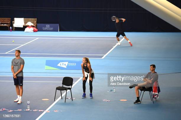 Lloyd Glasspool Katie Boulter and Jamie Murray watch on during Day One of the St James's Place Battle Of The Brits Team Tennis at National Tennis...