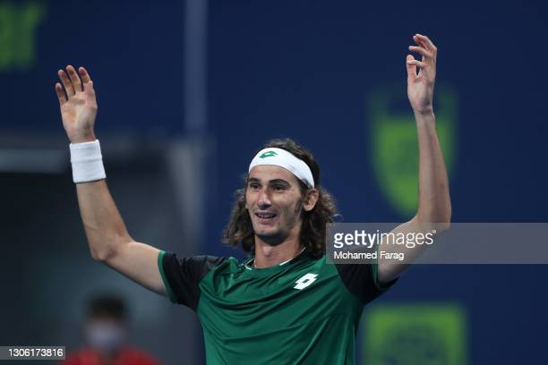 Lloyd Harris of South Africa celebrates match point during his round one match against Stan Wawrinka of Switzerland during Day 2 of the Qatar...