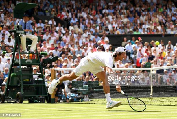 Lloyd Harris of South Africa plays a forehand in his Men's Singles first round match against Roger Federer of Switzerland during Day two of The...