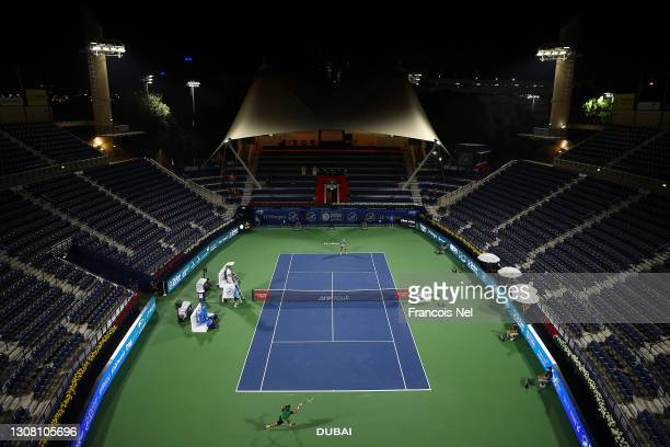 Lloyd Harris of South Africa returns the ball during the men's singles Final match against Aslan Karatsev of Russia during day fourteen of the Dubai...