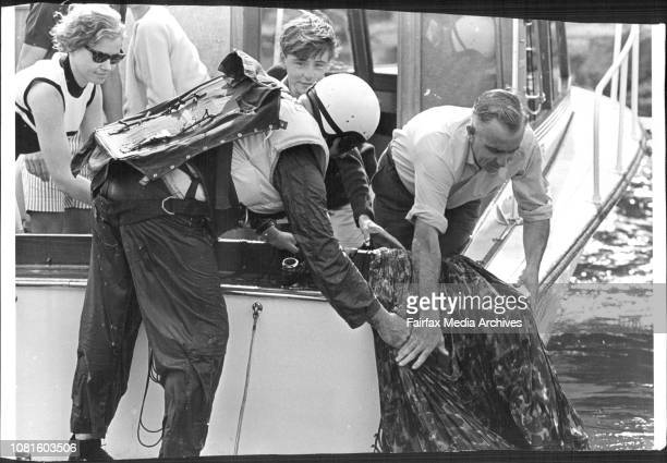 Lloyd is helped as he recovers his chute from the water after being picked up3 men parachuted from a Cessna aircraft flying at 2500 feet into the...