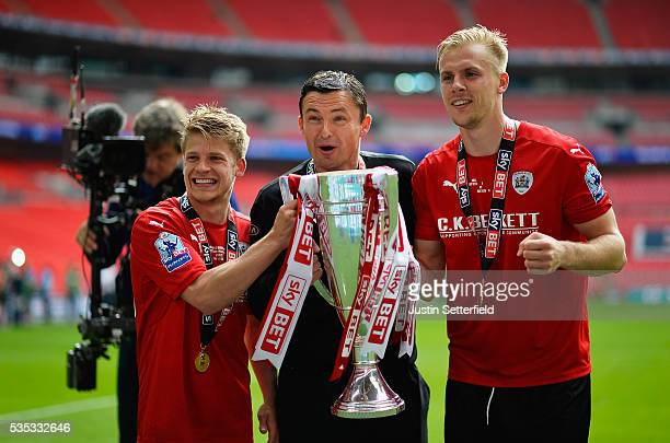 Lloyd Isgrove of Barnsley FC Manager of Barnsley FC Paul Heckingbottom and Marc Roberts of Barnsley FC celebrate after wiining the Sky Bet League One...