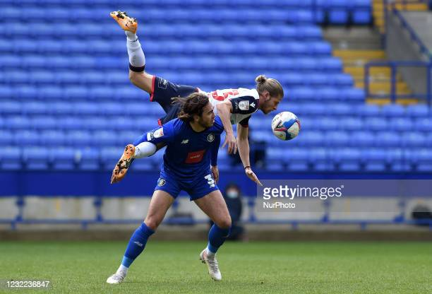 Lloyd Isgrove of Bolton Wanderers tussles with Dan Jones of Harrogate Town during the Sky Bet League 2 match between Bolton Wanderers and Harrogate...