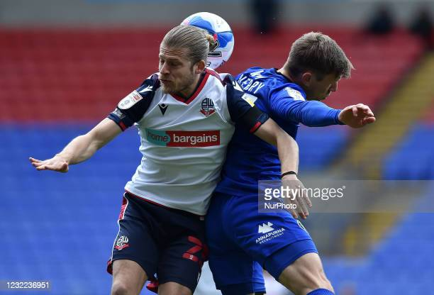 Lloyd Isgrove of Bolton Wanderers tussles with Lloyd Kerry of Harrogate Town during the Sky Bet League 2 match between Bolton Wanderers and Harrogate...