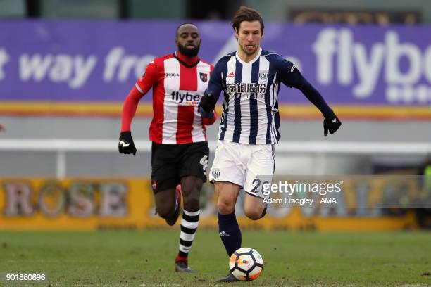 Lloyd James of Exeter City and Grzegorz Krychowiak of West Bromwich Albion during to the The Emirates FA Cup Third Round match between Exeter City v...