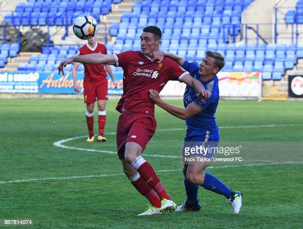 Lloyd Jones of Liverpool and Kiernan DewsburyHall of Leicester City in action during the Liverpool v Leicester City PL2 game at Prenton Park on...
