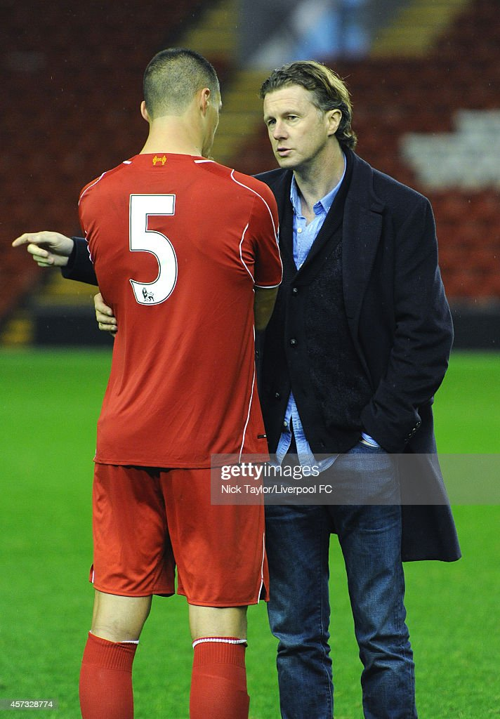 Lloyd Jones of Liverpool with former Liverpool player Steve McManaman after the Barclays Premier League Under 21 fixture between Liverpool and Southampton at Anfield on October 16 in Liverpool, England.