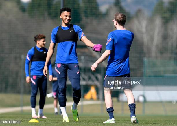 Lloyd Kelly and Oliver Skipp of England smile during an England Under-21 Training Session at NNC Brdo on March 30, 2021 in Kranj, Slovenia.