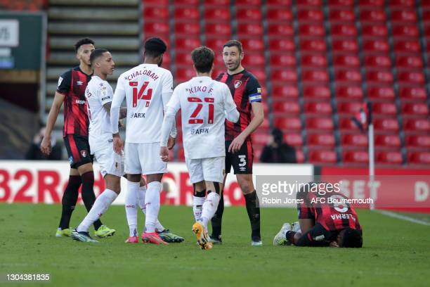 Lloyd Kelly and Steve Cook of Bournemouth stand between Nathaniel Chalobah and Joao Pedro of Watford after Lerma is fouled by Chalobah during the Sky...