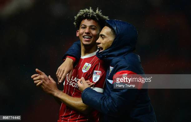 Lloyd Kelly and Zak Vyner of Bristol City celebrate after winning the match during the Sky Bet Championship match between Bristol City and Reading at...