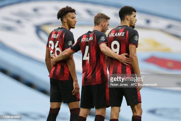 Lloyd Kelly Dan Gosling and Dominic Solanke of Bournemouth during the Premier League match between Manchester City and AFC Bournemouth at Etihad...
