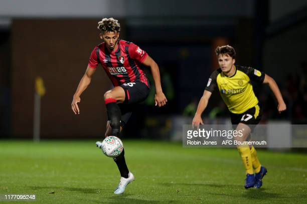 Lloyd Kelly of Bournemouth and Oliver Sarkic of Burton Albion during the Carabao Cup Third Round match between Burton Albion and AFC Bournemouth at...