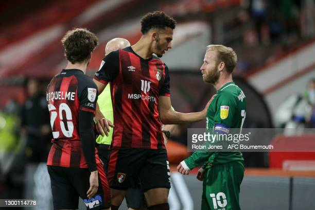 Lloyd Kelly of Bournemouth steps in between Rodrigo Riquelme and Barry Bannan of Sheffield Wednesday during the Sky Bet Championship match between...