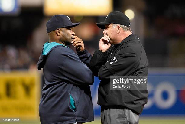 Lloyd McClendon manager of the Seattle Mariners disputes a call with first base umpire Dale Scott during the ninth inning of a baseball game against...