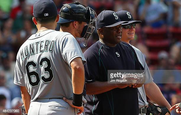 Lloyd McClendon of the Seattle Mariners awaits his relief pitcher on the mound in the fifth inning against the Boston Red Sox at Fenway Park on...