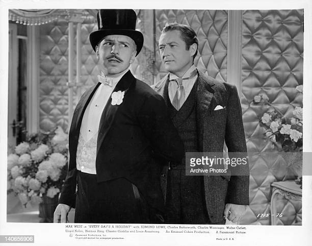 Lloyd Nolan has his armed pinned to his back by Edmund Lowe in a scene from the film 'Every Day's A Holiday' 1937