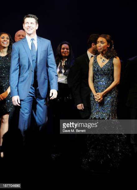 Lloyd Owen and Heather Headley bow at the curtain call during the press night performance of 'The Bodyguard' at the Adelphi Theatre on December 5...
