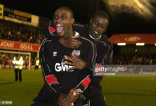 Lloyd Owusu and Darren Powell of Brentford celebrate after winning the Nationwide Division Two Play-off Semi-Final match between Brentford and...