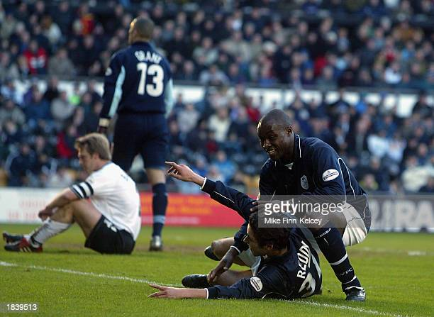 Lloyd Owusu and Michael Reddy of Sheffield Wednesday celebrate as Warren Barton of Derby County puts the ball into his own net to score an own goal...