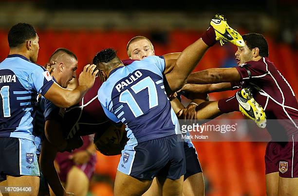 Lloyd Perrett of Queensland is tackled during the U20s State of Origin match between New South Wales and Queensland at Centrebet Stadium on April 20,...